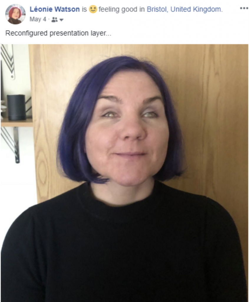 "Screenshot of Facebook status update. A photo of Léonie with her new purple hair is followed with status text stating ""reconfigured presentation layer"""
